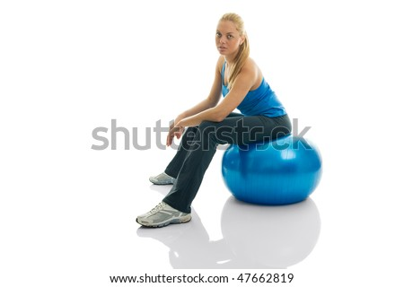 Young women sitting on fitness ball. Isolated on white - stock photo