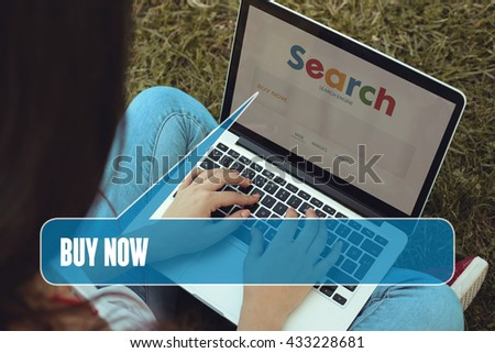Young women sitting on the grass on a Tablet PC is searching for Buy Now.
