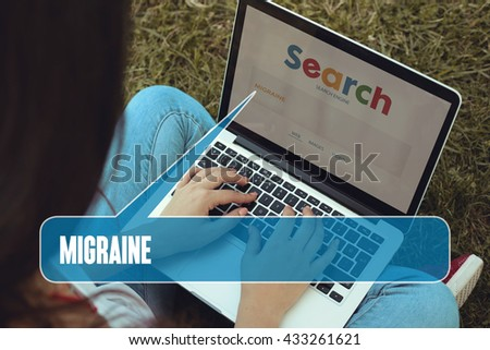 Young women sitting on the grass on a Tablet PC is searching for Migraine.
