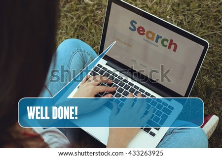 Young women sitting on the grass on a Tablet PC is searching for Well Done!. - stock photo