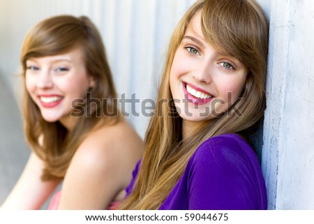 Young women smiling - stock photo