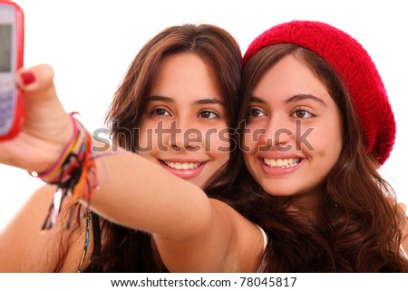 young women take a photo over white background - stock photo