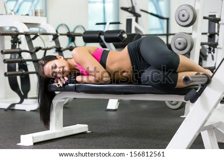 Young women take a rest at the gym - stock photo