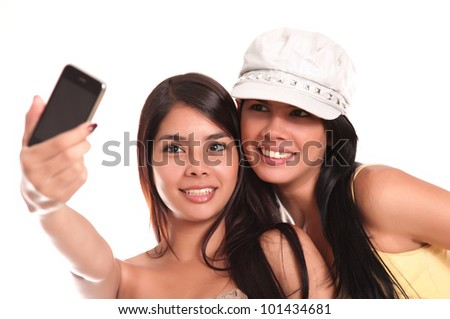 young women taking a picture with your mobile phone - stock photo