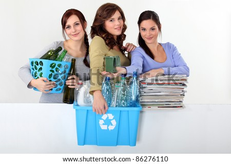 Young women taking out the recycling - stock photo