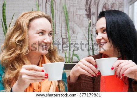 Young women talking in a small cafe