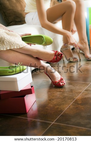 Young women trying on shoes - stock photo