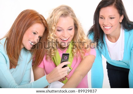 Young women using a cellphone - stock photo