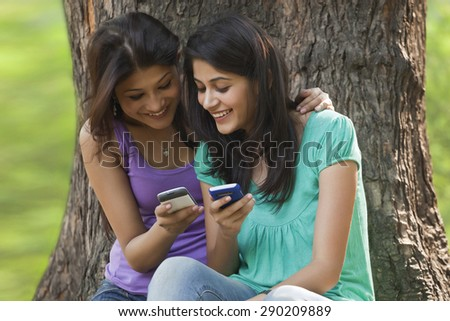 Young women using cell phone - stock photo