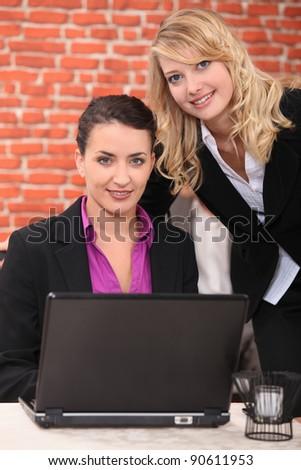 Young women using laptop computer - stock photo