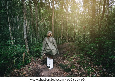 Young Women Walking on the Rough Road into the Forest for Trekking Outdoor Travel Lifestyle Concept