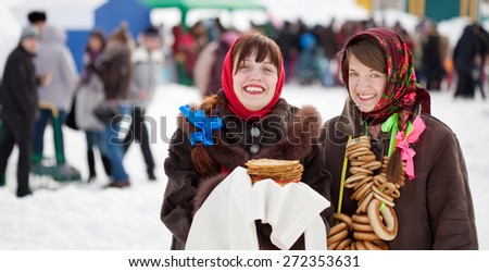 Young women with pancake during  Shrovetide at Russia - stock photo