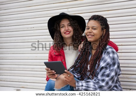 young women with the tablet on the street