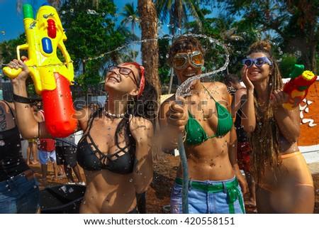 Young women with water guns has a fun - stock photo