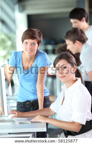 Young women working in the office - stock photo