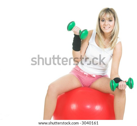 Young women working out on pilates ball. Fitness girl smiling and exercise on fitball. Isolated on white - stock photo
