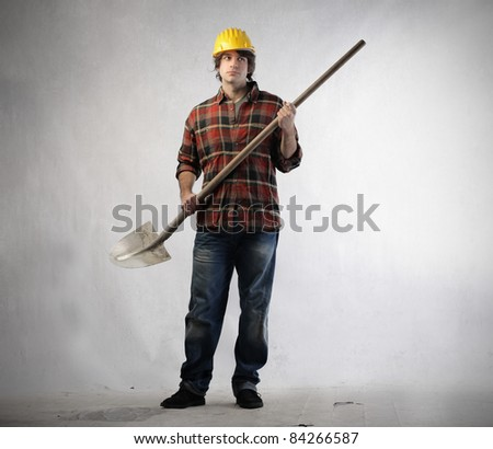 Young worker holding a shovel