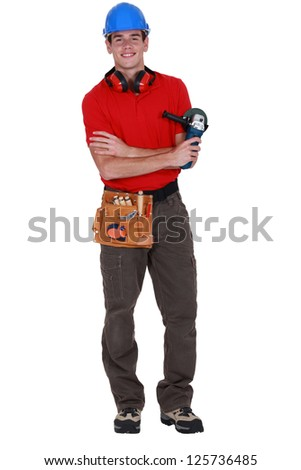 Young worker holding angle grinder - stock photo