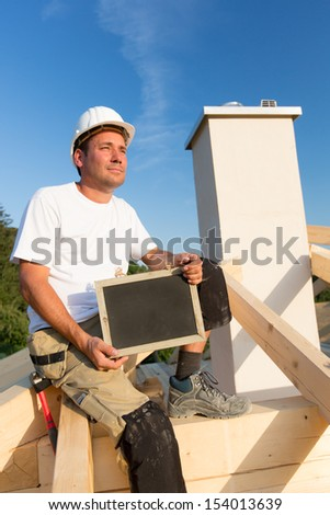 Young worker holds a sign in his hands. - stock photo
