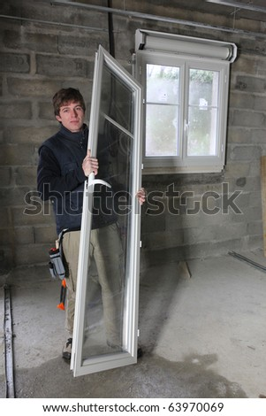 Young worker in a house under construction - stock photo
