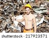 young worker in a junkyard - stock
