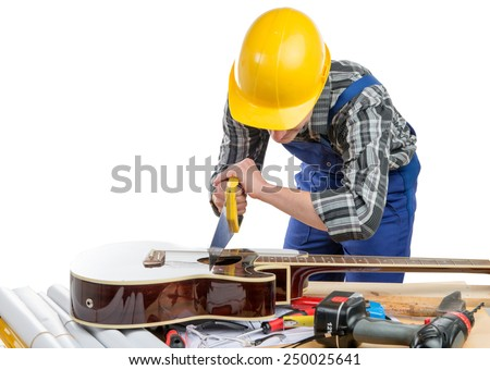 young worker plays music with a saw and a guitar