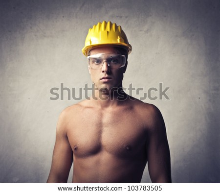 Young worker wearing a security cap - stock photo