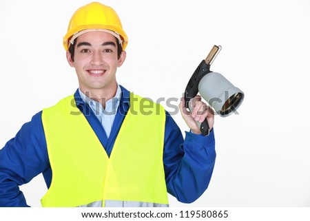 Young worker with blow torch - stock photo