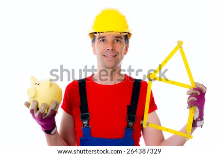 young worker with folding yardstick house and piggy bank - stock photo