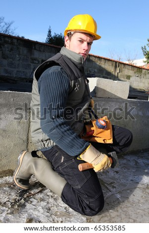 Young worker with helmet