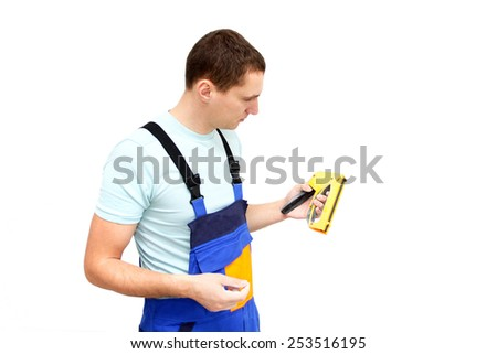Young worker with stapler isolated on white - stock photo