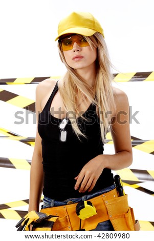 Young worker woman with tools for construction