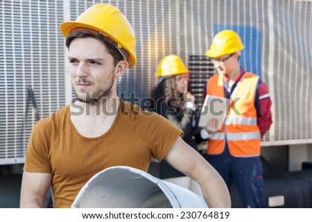 young workers in a junkyard
