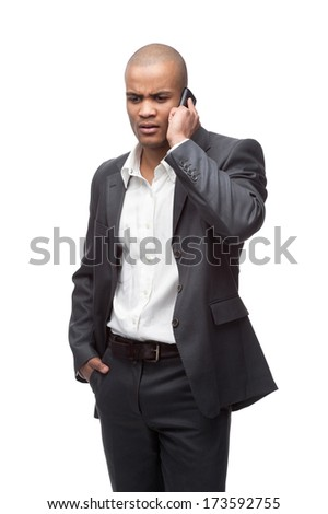 young worried black businessman talking on cell phone isolated on white - stock photo