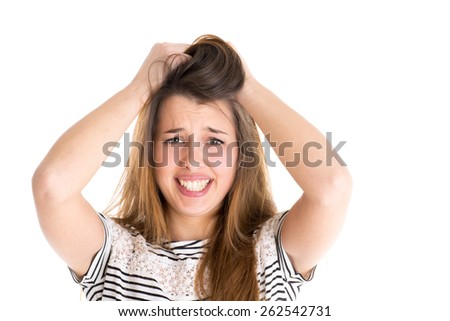 Young worried cute woman on white background