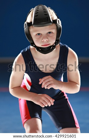 Young wrestler in his stance - stock photo