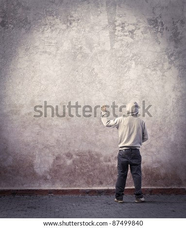 Young writer starting to draw a graffiti - stock photo