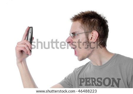 Young 18 year old adult teenager yells into his wireless phone isolated on white background. - stock photo