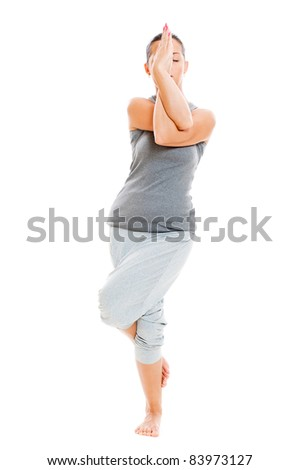 young yoga female doing yogatic exercise. isolated on white background - stock photo