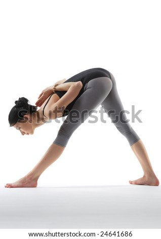 young yoga female doing yogatic exericise - stock photo