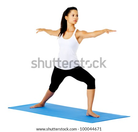 Young yoga woman warrior pose. This is part of a series of various yoga poses by this model, isolated on white - stock photo