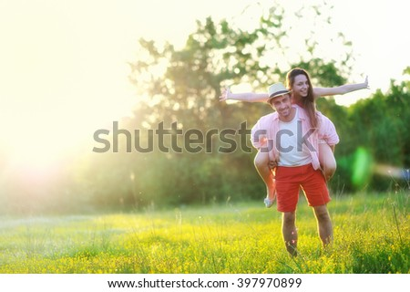 young young couple in love having fun and enjoying the beautiful nature - stock photo