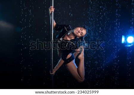 Young Young sexy woman pole dancer. Water studio photo sexy woman pole dancer. Water studio photo - stock photo