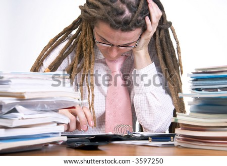 Young yuppie having tough time with the paperwork