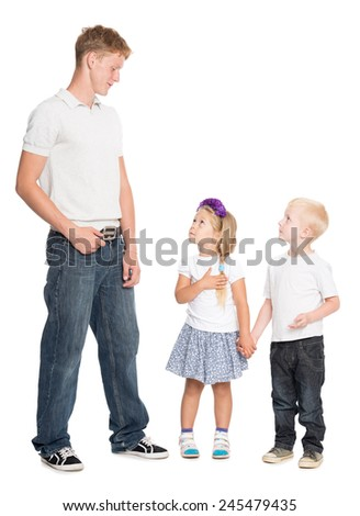 Younger brother and sister look with admiration at his older brother - stock photo