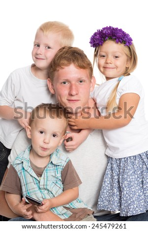 Younger brothers and sister with elder brother - stock photo