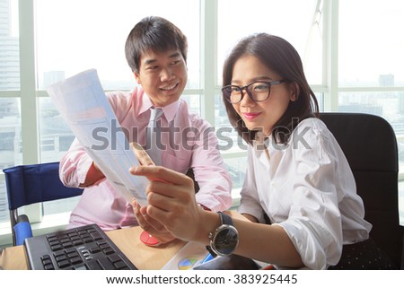 younger man and woman meeting in office working table