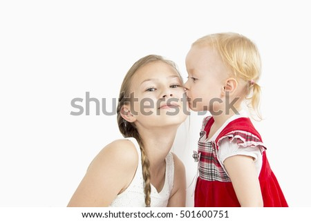 younger sister kissing elder