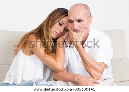 Younger woman gives support to an elderly man - stock photo