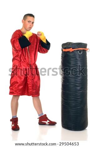 Youngster practicing the art of boxing with a punch-bag, studio shot on white background - stock photo